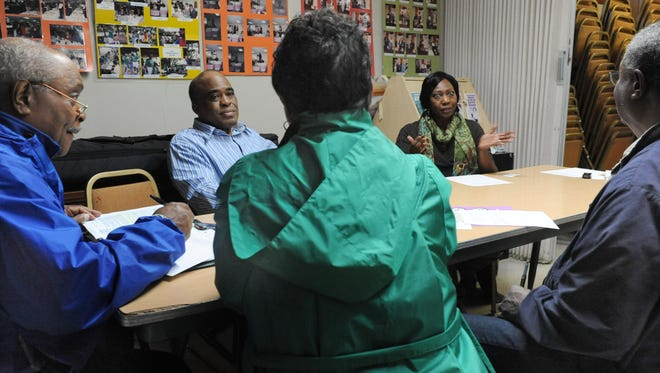 William Head, left, Richard Coure, Pinky Noble-Britton, Harvey Major and Cheryl Major met in March to plan the first Father and Son Wellness Fair, set for June 20, which focuses on the health needs of black men. The fair will be at Fisk University from 9 a.m. to 2 p.m.