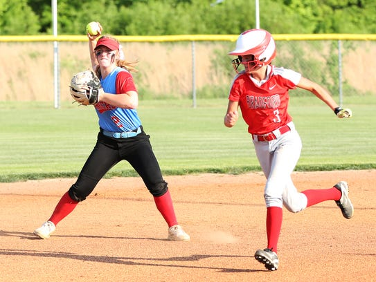 Gibson County's Macey Neal looks to throw to third