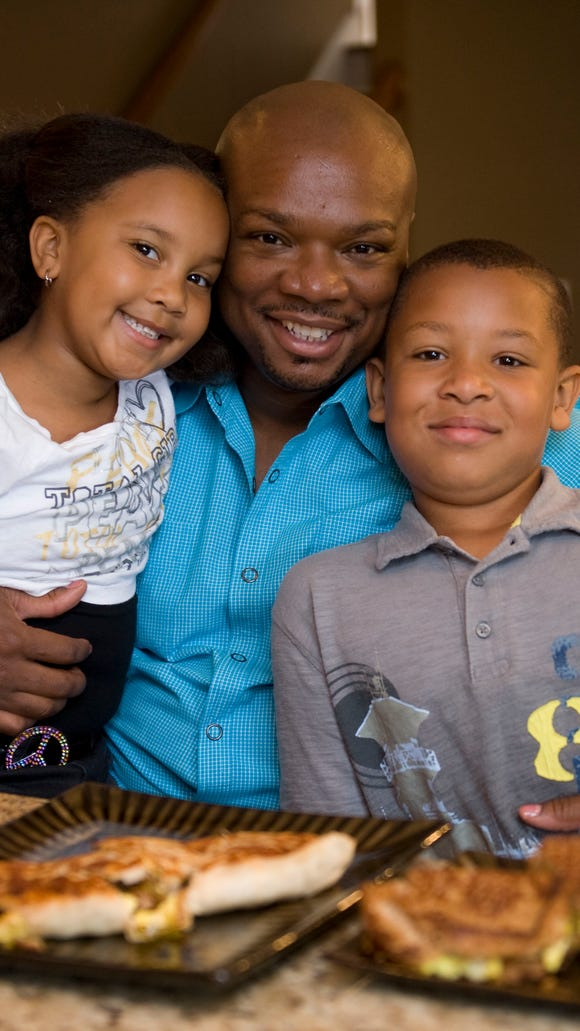 Aaron McCargo  with his son Justin, 9, and daughter Jordan, 6, at his home in 2011.