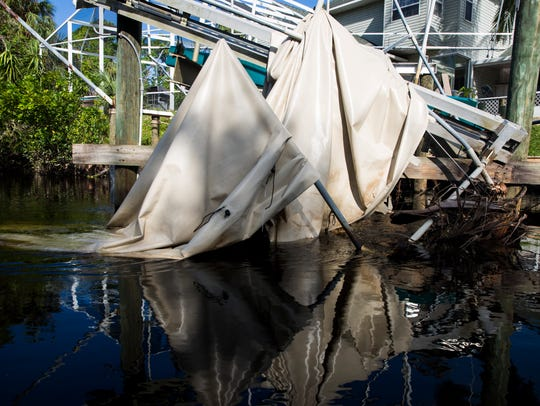 A boat dock canopy, destroyed by Hurricane Irma, sits