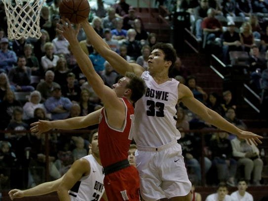 Bowie's Daniel Mosley blocks the layup of  Holliday's