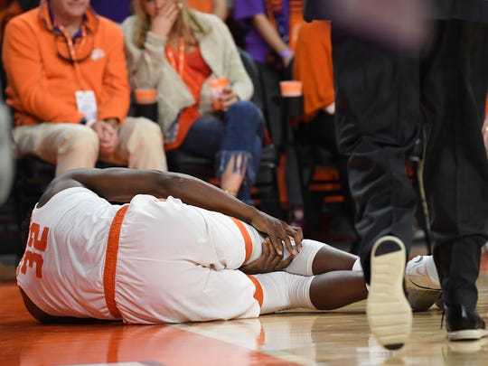 Clemson forward Donte Grantham (32) lays on the court after injuring his right knee during the 2nd half against Notre Dame on Saturday, January 20,  2018 at Clemson's Littlejohn Coliseum.