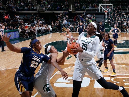 Michigan State's Victoria Gaines (15) comes down with