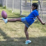 Brianna Hills, 8, oat the NFL Punt, Pass & Kick Competition at Donatoni Park in Rockaway Borough, July 23, 2015.