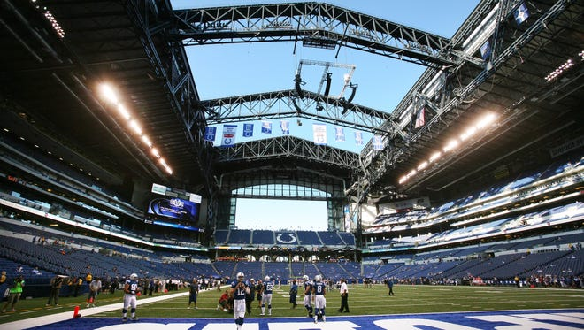 Investigators don't know yet why a 7/8-inch bolt fell from the roof of 7-year-old Lucas Oil Stadium during an Indianapolis Colts preseason game Sept. 3, or whether opening the retractable roof caused the accident. Quarterback Andrew Luck and teammates are shown warming up with the roof open before the start of the game with the Cincinnati Bengals in 2012.