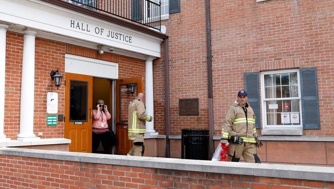 Lancaster firefighters walk out of the Fairfield County Hall of Justice Thursday, June 28, 2018, in downtown Lancaster.