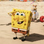 """This image released by Paramount Pictures and Nickelodeon Movies shows characters, from left, Squidward Tentacles, SpongeBob SquarePants, Sandy Cheeks, and Mr. Krabs in a scene from """"The Spongebob Movie: Sponge Out of Water."""""""
