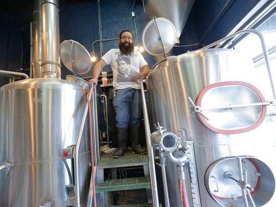 This is the guy you want making your beer, Ode Brewing brew master Albert Salinas. Here he stands proudly atop the tanks as they cook up a fresh batch of suds.