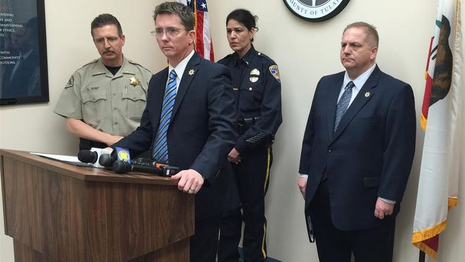 District Attorney Tim Ward begins a press conference Tuesday to announce charges for accused cop killer Erika Sandoval.
