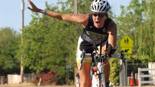 Elizabeth Dansie competes in the 2015 St. George Ironman 70.3 mile triathlon Saturday, May 2, 2015. Dance was the first local female athlete to finish the 2015 St. George Ironman.