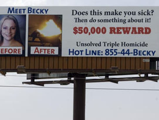 This file photo shows a billboard advertising a reward