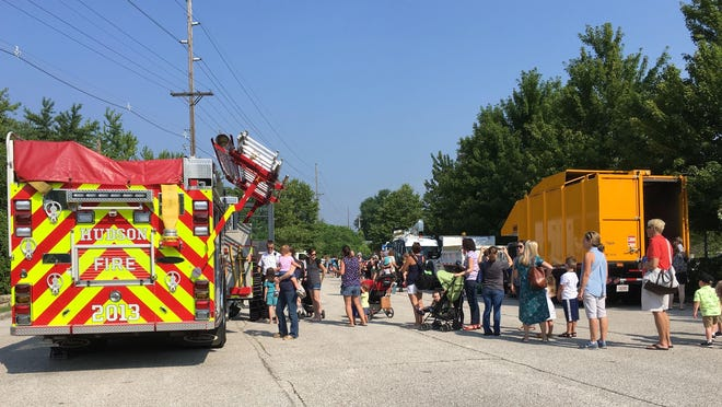 People line up to check out a fire engine at a past Touch a Truck event at the Hudson Library and Historical Society, which reopened Wednesday.
