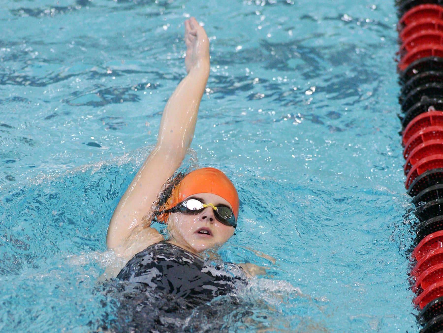 Watkins Memorial senior Hailey Miller practices her backstroke during practice Nov. 24 at Denison.