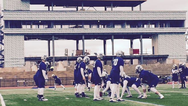 The Monmouth University football team conducted spring practice on Wednesday in the shadow of what will be their new stadium, set to be completed by the start of the 2017 season.
