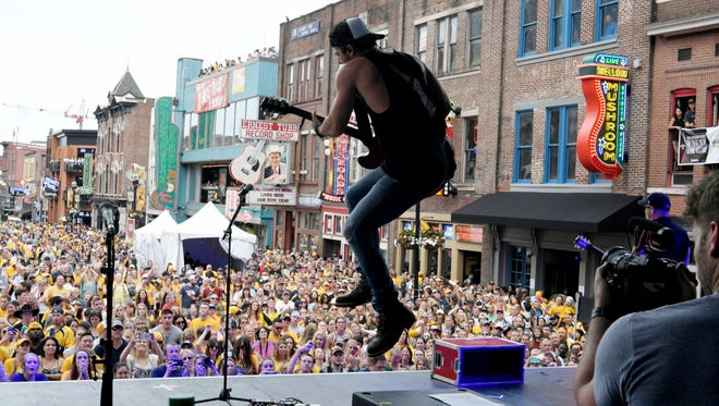 Kip Moore performs on Lower Broadway before Game 4 of the Stanley Cup Final on June 5, 2017, in Nashville.