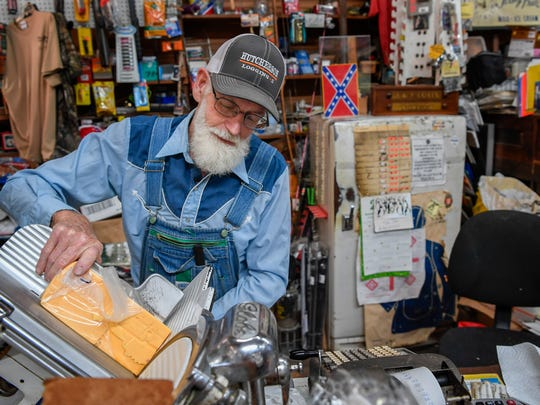 Wilson Fly slices cheese for a customer at the Fly General Store in Santa Fe, Tenn., Thursday, May 18, 2017.