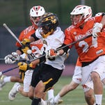 Lakeland/Panas'  Brian Toy (18) has the ball knocked away by Mamaroneck's Daniel O'Rourke (24) during the Section 1 championship game at White Plains High School May 25, 2016.