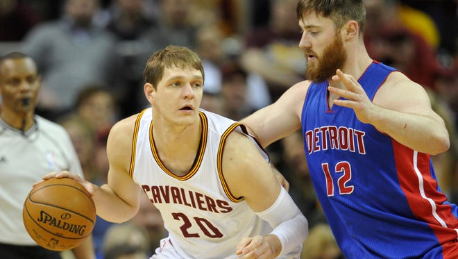 Cavaliers center Timofey Mozgov (20) dribbles against Pistons center Aron Baynes (12) in the first quarter Wednesday in Cleveland.