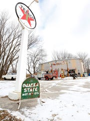 A lollipop-shaped Texaco sign beckons travelers to stop by and see Bob Norris's retro gas station circa: 1950's, set up in front of Grade A Welding along Lakeshore Drive, just north of Fond du Lac.