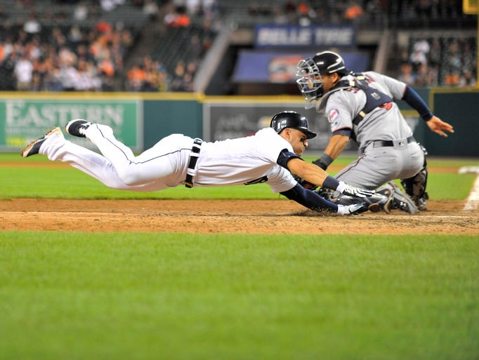 Tigers' Jose Iglesias is called safe at home scoring