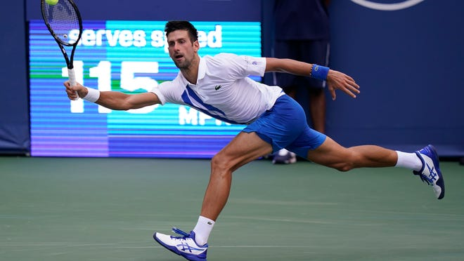 Novak Djokovic, of Serbia, returns a shot to Roberto Bautista Agut, of Spain, during the semifinals at the Western & Southern Open tennis tournament Friday, Aug. 28, 2020, in New York. (AP Photo/Frank Franklin II)