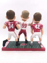 The three Watt brothers are portrayed in Badgers gear in a bobblehead produced by the National Bobblehead Hall of Fame and Museum.