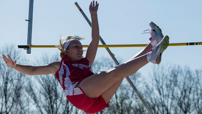 Dixie Heights' Sara Edgett competes in the pole vault during the NKAC big-school relay meet Tuesday.
