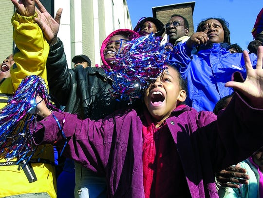 Thadijah Burks, 7, of Jackson, screams for some candy