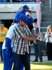 Bubba Watson gets batting tips from mascot Kazoo at Blue Wahoos Stadium after announcing in 2015 that he would be a part owner of the Pensacola Blue Wahoos with Quint and Rishy Studer.