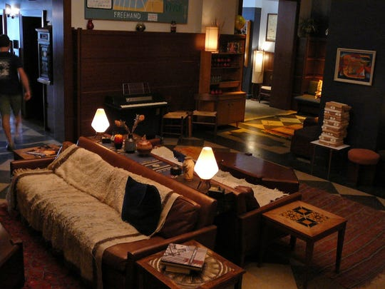 The lounging area at Freehand Chicago is next to Café Integral, so overnight guests and the public can use the space.