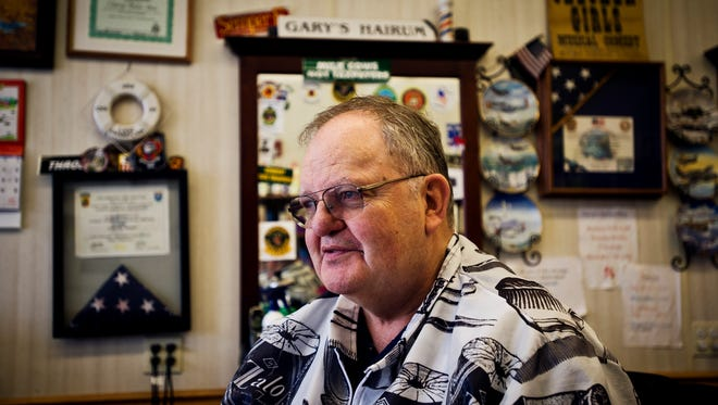 """Surrounded by memorabilia ranging from a framed America flag, a pencil sketch of a F-16 signed by what looks like every pilot at the VNAG, and a sign that read's """"Garry's Hairum"""" just to name a few, is where you'll find Garry Montague, who has been cutting hair at Garry's Barbershop in Essex Junction for 50 years."""