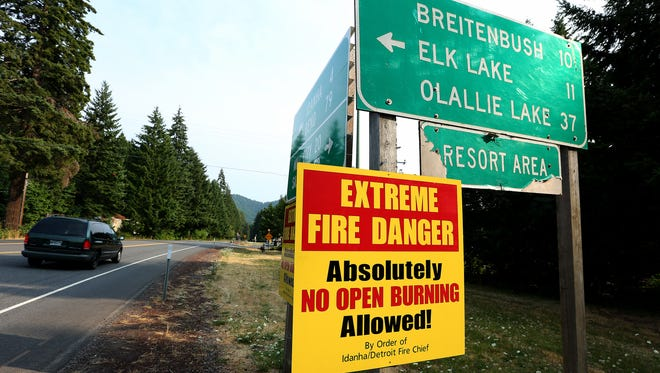 An extreme fire danger sign alerts visitors to an open burning ban along the N Santiam Highway, Monday, August 3, 2015, in Detroit, Ore.
