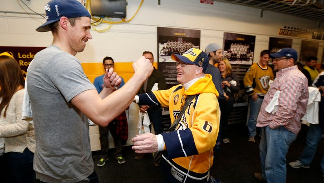Best Buddies: Mike Maguire, right, with Pekka Rinne after a Predators game at Bridgestone Arena on Nov. 22.