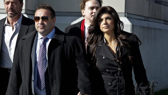 Teresa Giudice and her husband Giuseppe 'Joe' Giudice (L) leave Newark federal court on November 20, 2013 in Newark, New Jersey.