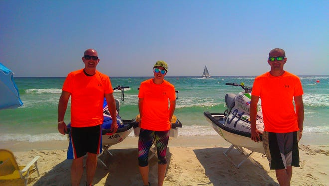 Bill, Morgan and Billy Beers pose together with their jet skis.