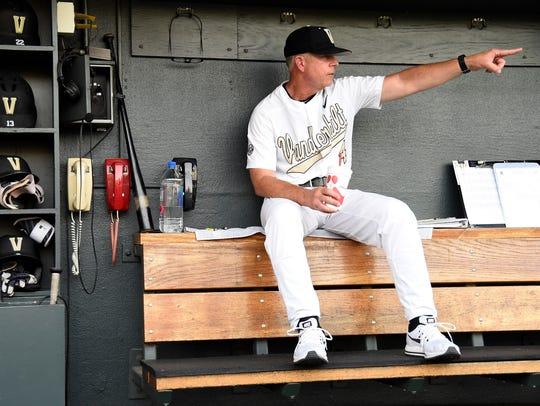 Vanderbilt head coach Tim Corbin watches warm-ups at