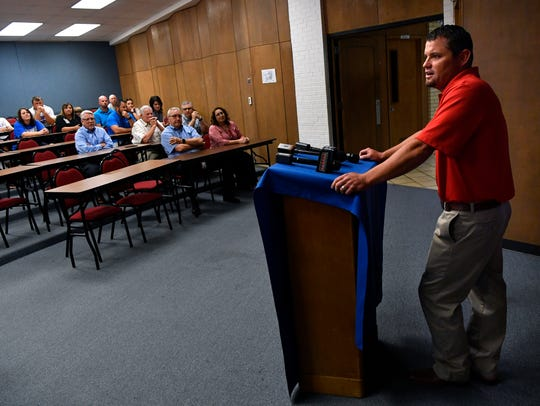 Aaron Roan, the football defensive coordinator for Cooper High School, addresses media and district staff after being named head football coach and athletic director for the Cougars on Monday.