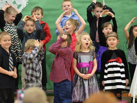 The Nasonville School kindergarten through second grade students performed their winter concert Dec. 16 led by their music teacher, Kristine Johanek. The performances incorporated singing, movement, bells and other instruments. Pictured are Nasonville kindergarten students performing their Five Little Snowmen song.
