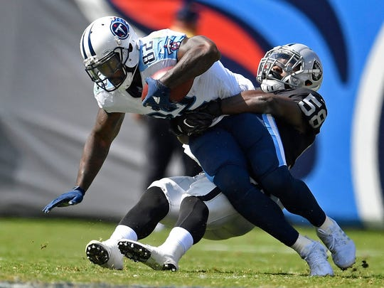 Tennessee Titans tight end Delanie Walker (82) catches a pass over Oakland Raiders linebacker Tyrell Adams (58) in the second half at Nissan Stadium Sunday, Sept. 10, 2017 in Nashville, Tenn.