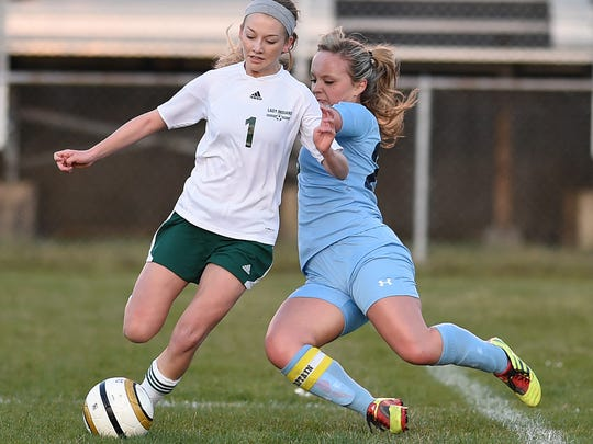 Indian River's Brooke Beam moves the ball past Cape's