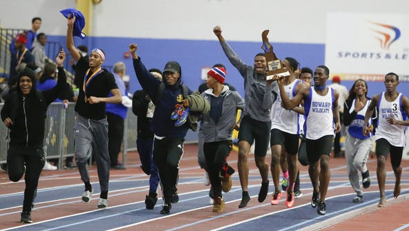 Howard celebrates the boys team title at the conclusion