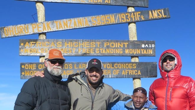 Pat Ross, far left, stands with his son, Chaney, before climbing Mount Kilimanjaro on New Year's Day.