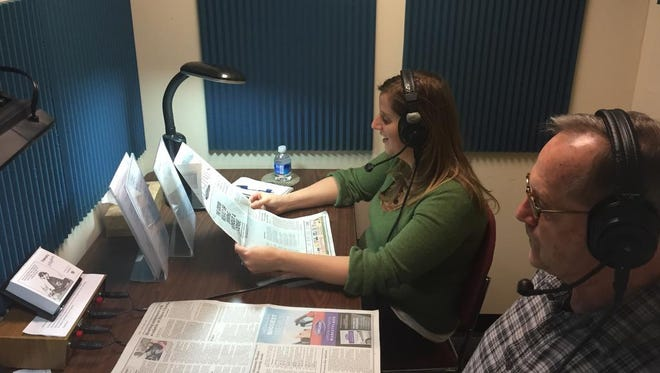 Mountain Area Radio Reading Service Volunteer Jon Moore shows Reporter Beth Walton how the group broadcasts local news for the visually impaired.