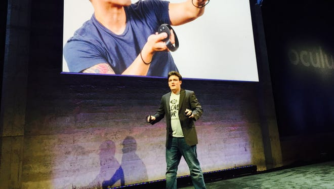 Oculus Rift designer Palmer Luckey talks about his device  at a news conference. The VR goggle is supposed to be available to developers in 2016.