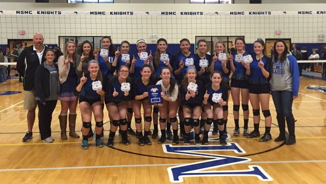 The Millbrook High School volleyball team poses with the Section 9 Class C plaque.