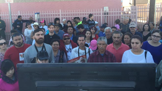 People watching the papal Mass on a TV setup outside in Segundo Barrio. Pope Francis gave Mass in Juárez on Wednesday, Feb. 17.