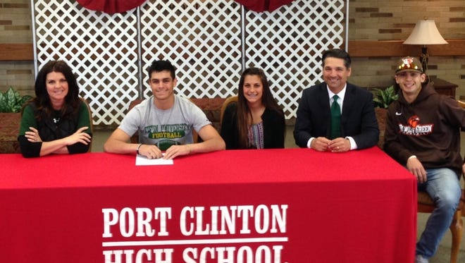 Port Clinton's Aidan Rospert, second from left, announced Monday he will continue his football career at Tiffin University. He is joined by mother, Mary Jo; sister, Isabelle; father, Jeff; and brother, Addison.