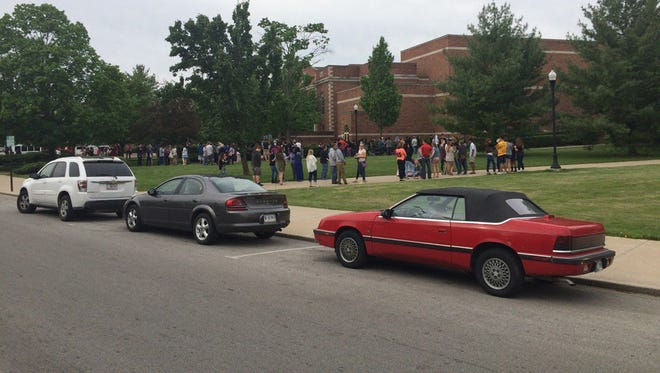 Richmond High School students wait outside the building Friday morning as smoke from a food fire is ventilated.