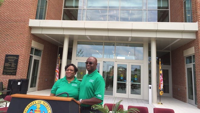 Juliette B. Bell, University of Maryland Eastern Shore president, and John Allen, regional vice president for Delmarva Power and chairman of the UMES Board of Visitors, pose after announcing a partnership Tuesday, July 19, 2016 to make UMES more environmental friendly.
