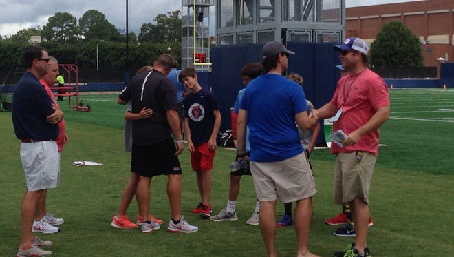 Ole Miss coach Hugh Freeze invited six of the children whose parents died in Sunday's plane crash to Tuesday's practice.